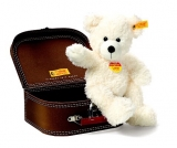 Lotte dangling Teddy bear in suitcase